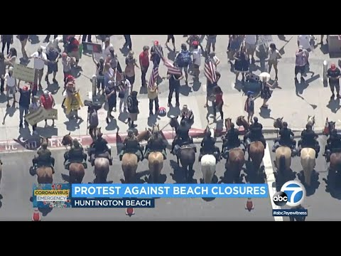 Large Crowds Gather In Huntington Beach To Protest Newsom Stay-at-home Orders