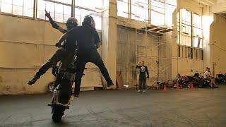 Pair Stunt Riding on Motorcycle