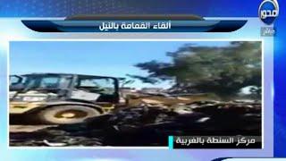 سيارة تابعة لمحافظة الغربية تلقي القمامة بنهر النيل