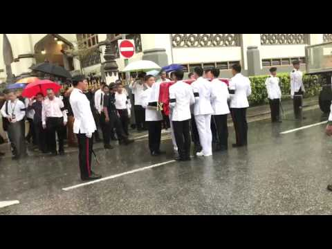 Rain pours as coffin bearers place casket on Gun Carriage