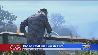 Pacific Palisades Homeowners Work To Protect Homes As Fire Creeps Near