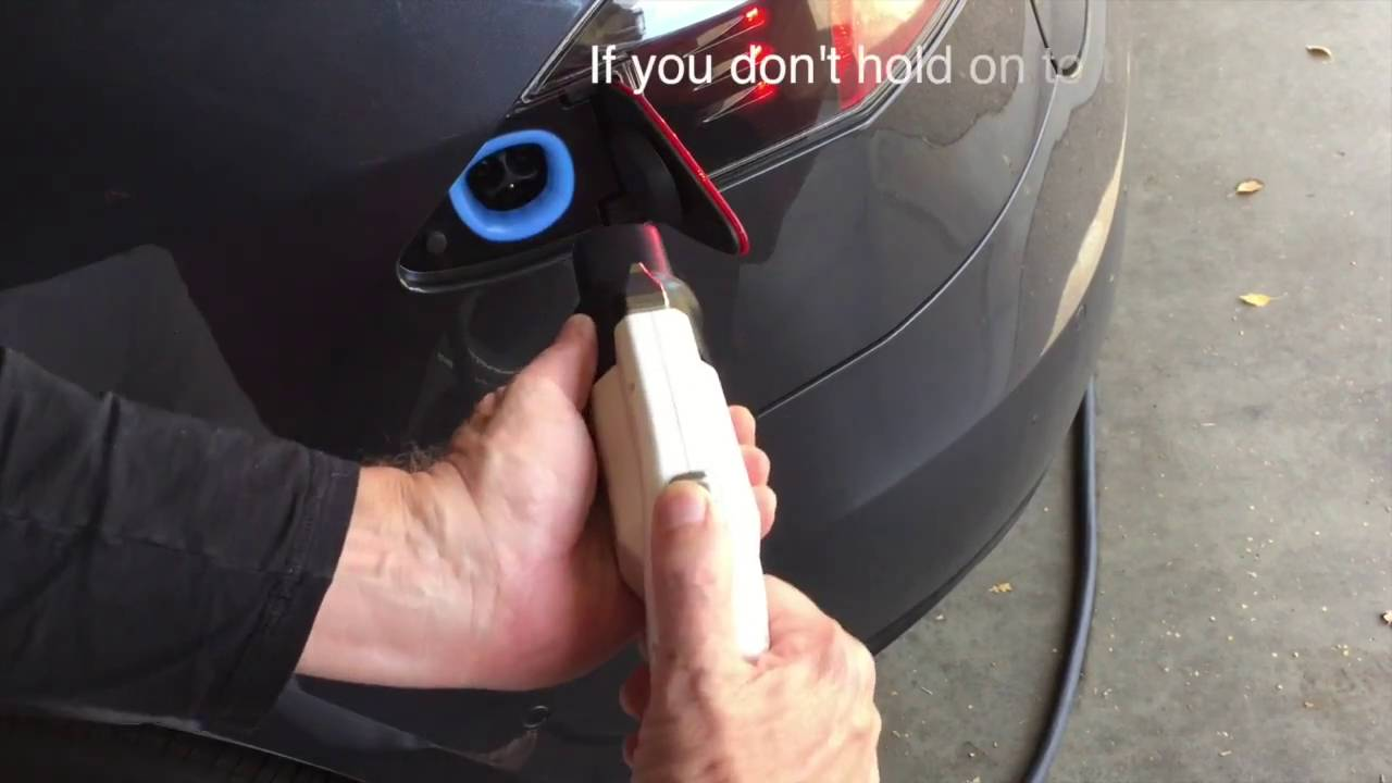 Removing SAE J1772 Level 2 charging cable from a TESLA charge port