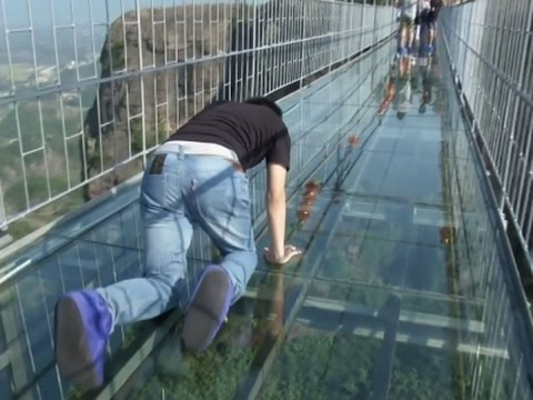 Raw: Tourists Brave Glass-Bottom Bridge