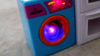 A flashy ball on spin cycle in a toy washing machine