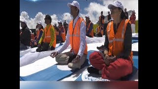 Watch: People perform yoga atop Swiss Alps
