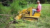 MAGNATRAC MH8500 drilling holes for fence posts - YouTube