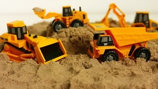 Caterpillar Toy Construction Vehicles and Machines Playing with Kinetic Sand