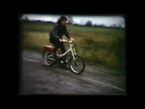 James & PD riding old Moped in Tennis Court - Aug 1973