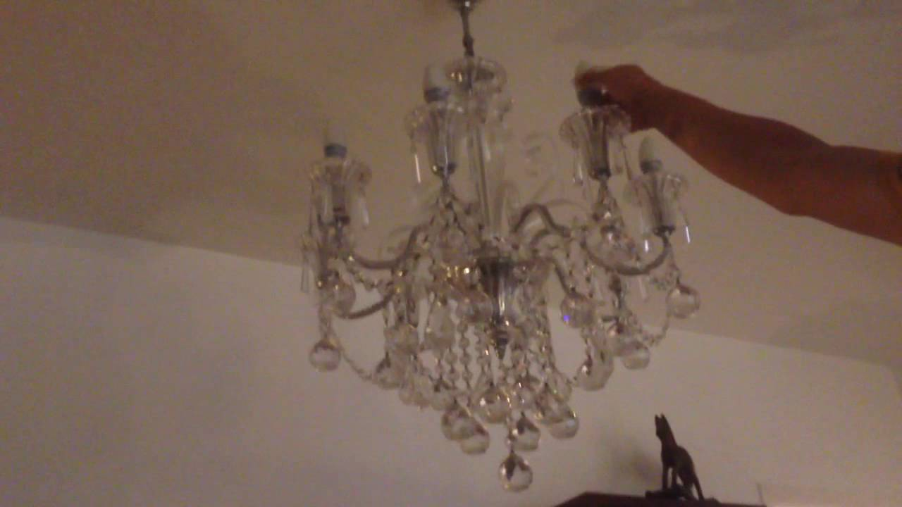 Replacing a burned out light bulb in the dining room light fixture ...