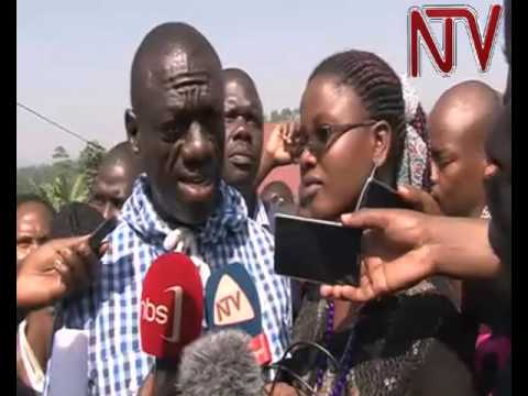 Besigye votes and talks to the press after casting his vote
