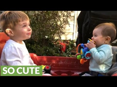 Baby boy thinks big brother is hilarious