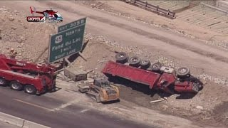 Dump truck tips over in Zoo Interchange construction zone