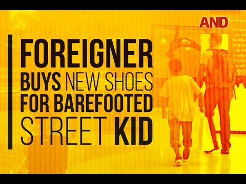 3c22f9fb10f60 Foreigner buys shoes for barefooted street kid. ABS-CBN News