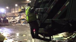 Garbage truck backing up
