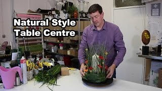 Natural Style Table Centre - With Mini Gerbera And Beargrass -