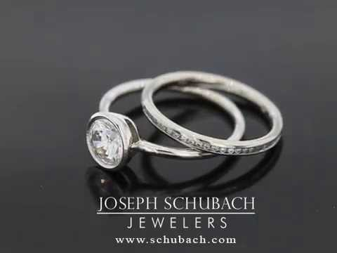 Round channel set diamond band with our round bezel set engagement