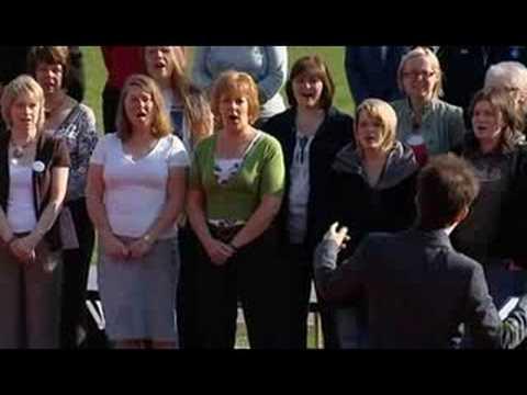 Teachers of Lancaster Boys sing 'World in Union' - Choir