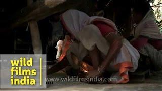Assamese folks making hando guri (food served during Bihu)