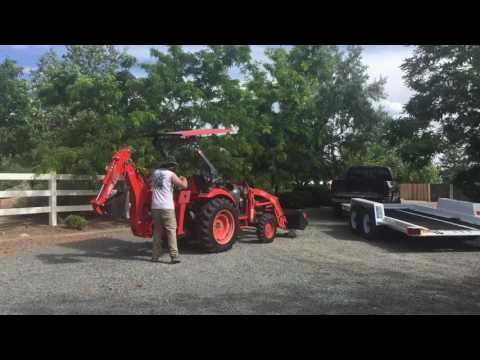 Tractor and Auger being returned.