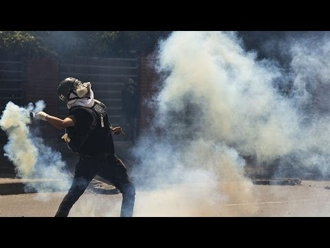 Protesters Battle Police on Streets of Caracas