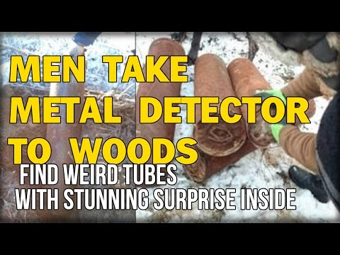 MEN TAKE METAL DETECTOR TO WOODS, FIND WEIRD TUBES WITH STUNNING SURPRISE INSIDE