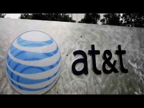MoneyWatch: AT&T sued over data throttling; Orbital stock plummets