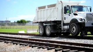 dump truck going up train track