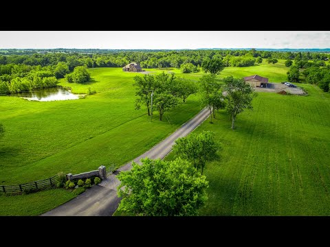 QUICK Aerial of this Multigenerational House Horse Property 25 acre Farm
