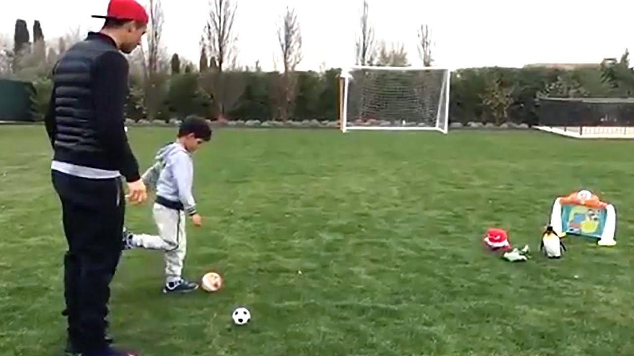 cristiano ronaldo practices free kicks in his garden with his son