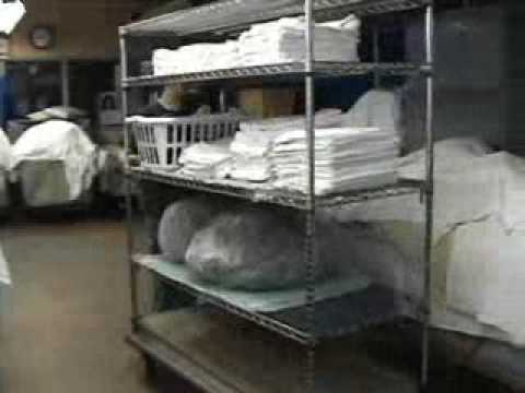 Motorized Clean Linen Wire Cart pushes clean linens in a hospital