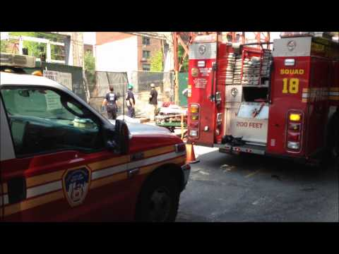 WORKER RESCUE - FDNY RESCUE 1, TOWER LADDER 12, SQUAD 18, ENGINE 24, RESCUE OPERATIONS, BATTALION 2.