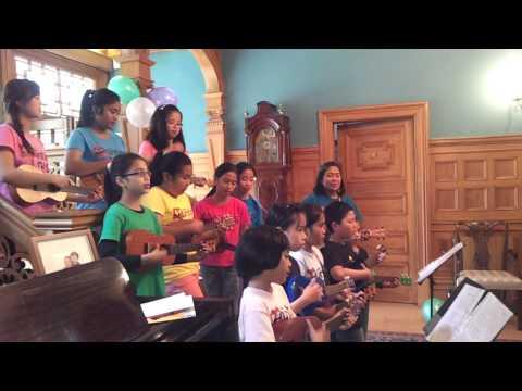 Munting Tinig serenading the British High Commissioner Jonathan Sinclair and staff