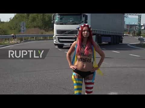 Ukraine: Topless anti-Saakashvili FEMEN protester detained at Polish border *EXPLICIT*