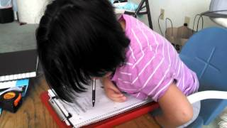 Arthrogryposis...Alexis doing homework