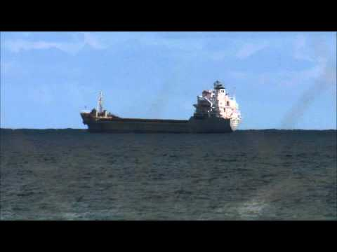 Cargo ship out at sea.