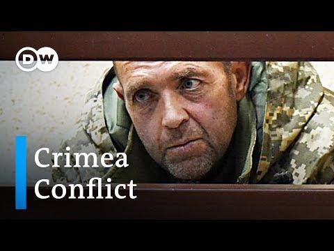 Russia releases 'confession' video of Ukrainian sailors | DW News