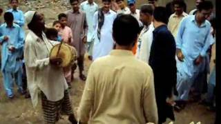 New Pashto Mast Attan And Picture  SonG singar noor mohammad kochi 2012.