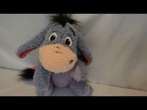Mattel Disney Eeyore Singing Giggle Stuffed Animal