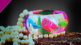 Epoxy.  Decoration from epoxy resin. Bracelet with shoes.  Filling transparent with dipit. Resin