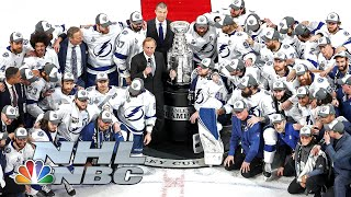 The tampa bay lightning go off traditional path and surround cup before it is presented to steven stamkos as team wins its second stanley tit...