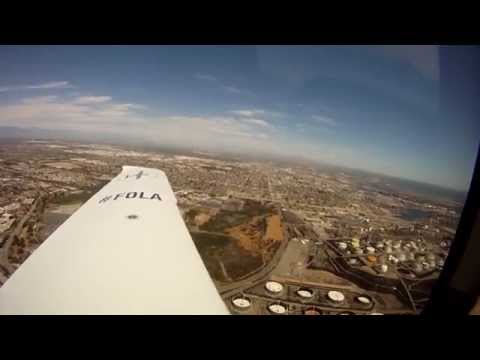 FLYING A PRIVATE CESSNA PLANE AROUND LOS ANGELES , HOLLYWOOD , BEVERLY HILLS , SANTA MONICA