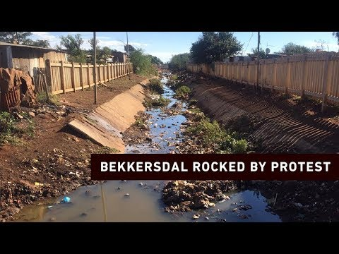 Download Bekkersdal police clash with protesters demanding a better life
