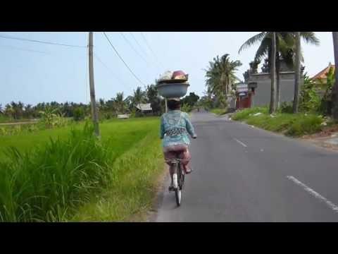 Balinese woman, incredible bike technique.