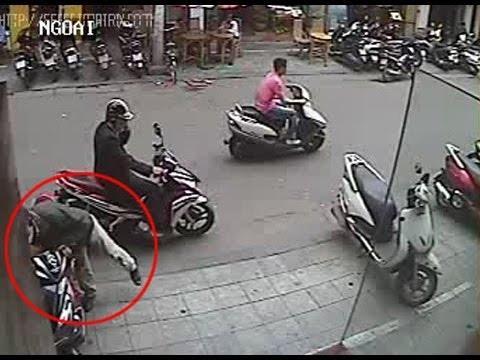 camera quay lại cảnh trộm xe chuyên nghiệp - camera videotaped a professional car thief