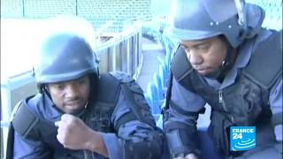 South African police trained in crowd control techniques