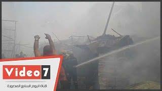 الحماية المدنية تحاول السيطرة على حريق سوق الملابس فى إمبابة