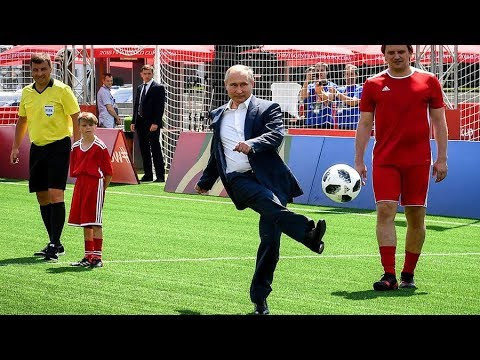 Putin it in the back of the net: Russian president has kickabout in Red Square