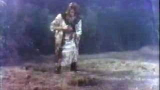 Stella Stevens falls in the mud during a rainstorm