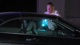 Woman found passed out in car on freeway