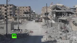 Raqqa in ruins: Drone buzzes Syrian city